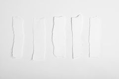 Top view of torn empty white note papers Stock Photo