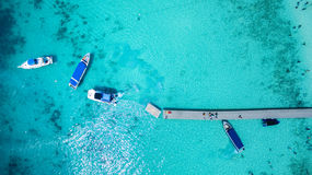 Top view of tourist speed boat approaching to floating port in p Stock Photos