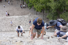Top view of tourists climb the Pyramid Nohoch Mul along the guiding rope at the Mayan Coba Ruins, Mexico.  royalty free stock photos