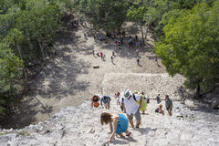 Top view of tourists climb the Pyramid Nohoch Mul along the guiding rope at the Mayan Coba Ruins, Mexico.  stock image