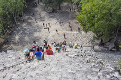 Top view of tourists climb the Pyramid Nohoch Mul along the guiding rope at the Mayan Coba Ruins, Mexico.  royalty free stock photo
