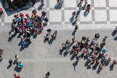 The top view on tourists on square. The top view on tourists standing on the Old Town Square in Prague. People are waiting for the show of the Prague Royalty Free Stock Photos