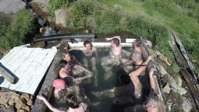 Top view of tourists take a bath in outdoors pool with thermal water stock video footage
