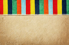 Top view towel on sandy beach. Background with copy space Royalty Free Stock Images