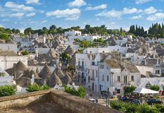 Top view on the town of Alberobello in Puglia, Italy. Alberobello, Italy - 11 May, 2014: a panoramic view on a beautiful particular extraordinary town in Puglia Stock Photography