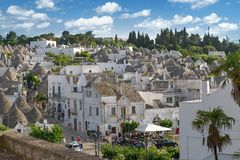 Top view on the town of Alberobello in Puglia, Italy. Alberobello, Italy - 11 May, 2014: a panoramic view on a beautiful particular extraordinary town in Puglia Royalty Free Stock Photography