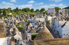 Top view on the town of Alberobello in Puglia, Italy. Alberobello, Italy - 11 May, 2014: a panoramic view on a beautiful particular extraordinary town in Puglia Royalty Free Stock Photo