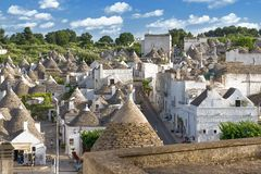 Top view on the town of Alberobello in Puglia, Italy. Alberobello, Italy - 11 May, 2014: a panoramic view on a beautiful particular extraordinary town in Puglia Royalty Free Stock Images
