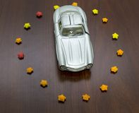 Top view of toy car in sugar stars in form circle royalty free stock images