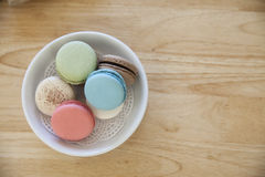 Top view traditional french colorful macarons in a dish on the t Royalty Free Stock Photo