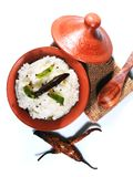 Top view of traditional homemade curd rice South Indian food. Traditional homemade curd rice South Indian food in a clay pot with fried buttermilk chilly and Royalty Free Stock Images