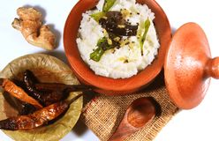 Top view of traditional homemade curd rice South Indian food. Traditional homemade curd rice South Indian food in a clay pot with fried buttermilk chilly,ginger Stock Images