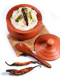 Top view of traditional homemade curd rice South Indian food. Traditional homemade curd rice South Indian food in a clay pot with fried buttermilk chilly and Stock Photography