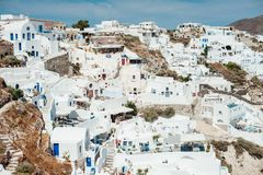 Top view of the traditional houses on the island of Santorini. Top view of the traditional white houses on the island of Santorini Stock Photos