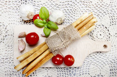 Top view of traditional italian breadsticks on wooden tray Royalty Free Stock Photo