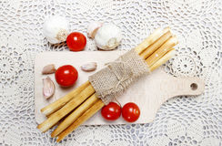 Top view of traditional italian breadsticks on wooden tray Stock Photo