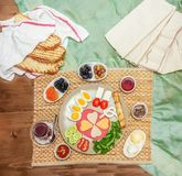 Top view of traditional Turkish breakfast served with cheese, salami, boiled egg, tomato, cucumber and toasted bread Royalty Free Stock Photography