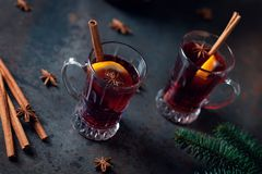 Top view of Traditional winter mulled wine in vintage glass on metallic background, selective focus and toned image. Sangria. On bar table. Celebration with Royalty Free Stock Photography