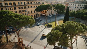 Top view: Traffic, Cars and buses at Piazza Venezia. Piazza Venezia is the central hub of Rome, Italy stock video footage