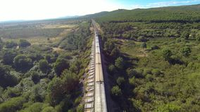 Top view of train. Over railway in the forest stock footage