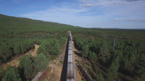 Top view of train in the wild. Aerial view of train over railway in the forest stock video footage