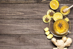 Top view of transparent cup of ginger tea with lemon, spices and Royalty Free Stock Image