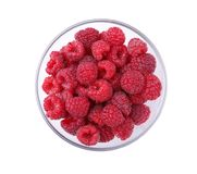 Top view of a bowl of raspberries isolated on a white background. Little ripe berry for cooking. Raspberries in a bowl. Top view of a transparent, glass, big Royalty Free Stock Photos