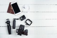 Top view travel concept with camera, passport and travel accessories on white wooden table background,. Tourist essentials stock photo