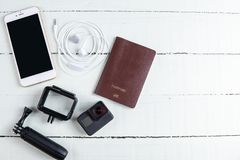 Top view travel concept with camera, passport and travel accessories on white wooden table background,. Tourist essentials royalty free stock photography