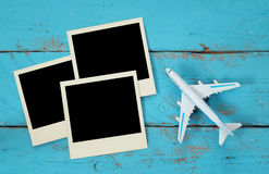 Top view of travel instant photographs next to airplane royalty free stock images