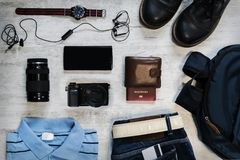 Top view travel items on the floor for mountain trip Stock Photos