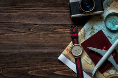 Top view of Traveler accessories and items man with black for planning travel vacations on the world, copy space. Travel and Summer holiday concept stock images