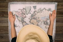 Woman in hat with map Stock Images