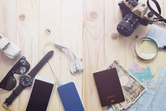 Top View Of Traveler`s Accessories Along For The Trip On Wooden. Table, Essential Vacation Items, Travel And Vacations Concept For Background Stock Photos