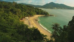 Top view of a tropical beach with tourists. Thailand, Phuket, Kamala. UltraHD video - Top view of a tropical beach with tourists. Thailand, Phuket, Kamala stock video