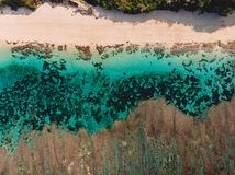 Top view of tropical beach with turquoise sea water and reef, aerial drone shot stock image