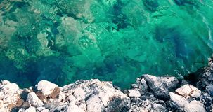Top of view of tropical caribbean beach green and blue sea with gold sand and rocks, holiday, slow sea movement relax and. Travel stock video