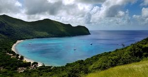 Top view from tropical island with perfect beach. With white sand and  turquoise water shielded with green hills Stock Photos
