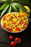 Top view-Tropical spicy mango salsa salad Stock Images