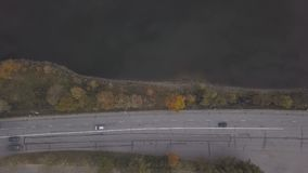 Top view trucks and cars moving on highway road on river background. Aerial landscape car driving on suburban road through river embankment stock footage