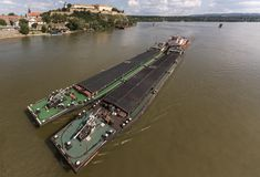 Tugboat Pushing a Heavy Barge. Top view of Tugboat pushing a heavy barge on the river Stock Images