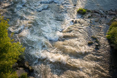 Top view of the turbulent river. Top view of the turbulent, fast, mountain river on a sunny summer day royalty free stock photos