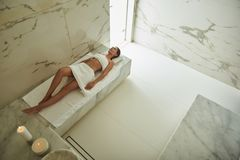 Top view of Turkish bath with beautiful slim lady relaxing in it royalty free stock images