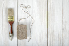 Top view of twine and brush on wooden DIY workbench with open space right side Royalty Free Stock Photography