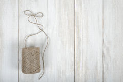 Top view of twine on wooden DIY workbench with open space right side Stock Photos