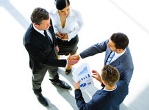Top view of a two businessman shaking hands. Welcome to business Royalty Free Stock Image