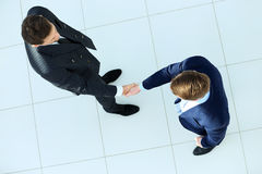 Top view of a two businessman shaking hands Royalty Free Stock Image