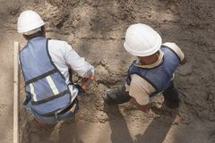 Two workers in a construction site Stock Photo