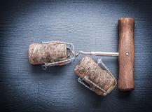 Top view two corks with wires of champagne and corkscrew Stock Image