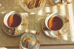 Top view of two cups of tea on wooden table. Toned. Royalty Free Stock Photography